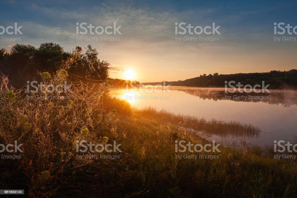 Sunrise landscape with foggy river stock photo