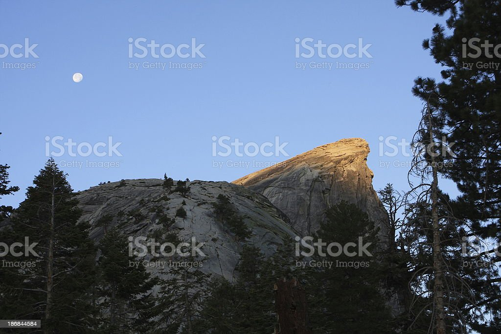 Sunrise Light on the Visor of Half Dome with Moon stock photo