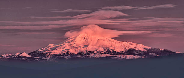Sunrise lights up Mt. Jefferson in the Cascade Mountain Range in Central Oregon View of Mt. Jefferson - a stratovolcano in the Cascade Volcanic Arc - as seen from Bend, Oregon lenticular cloud stock pictures, royalty-free photos & images
