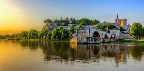 Sunrise of Avignon Bridge with Popes Palace, Pont Saint-Benezet, Provence, France stock photo