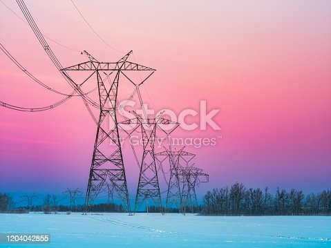 sunrise of prairie with power line in winter, alberta, canada.