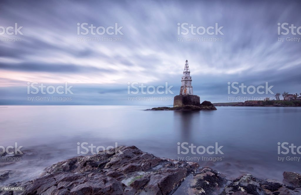 Sunrise of the lighthouse in Ahtopol, Bulgaria. Blue hour seascape. Long exposure stock photo