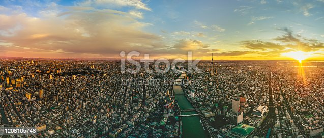 Asakusa district and skytree with dramatic sky at dawn in Tokyo, Japan