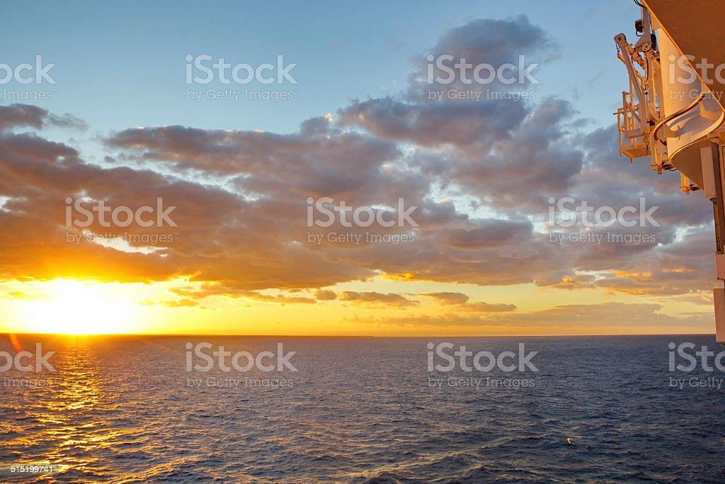 Sunrise off the ship's balcony. stock photo