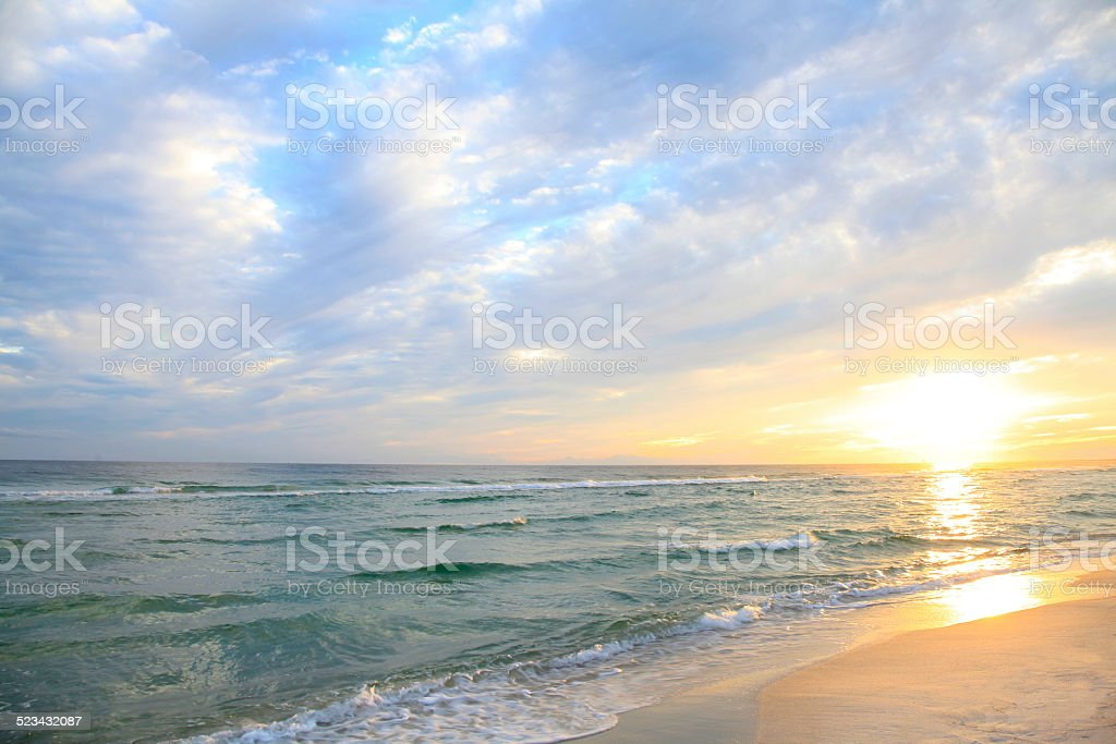 Sunrise on a Beautiful White Sand Beach in Florida stock photo