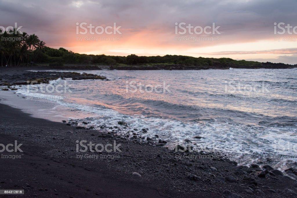 Sunrise on a Black Sand Beach stock photo