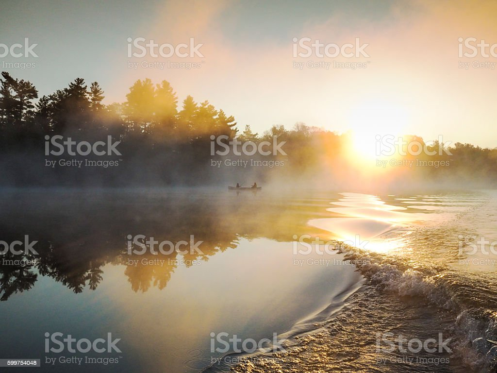 Sunrise on a northern lake stock photo