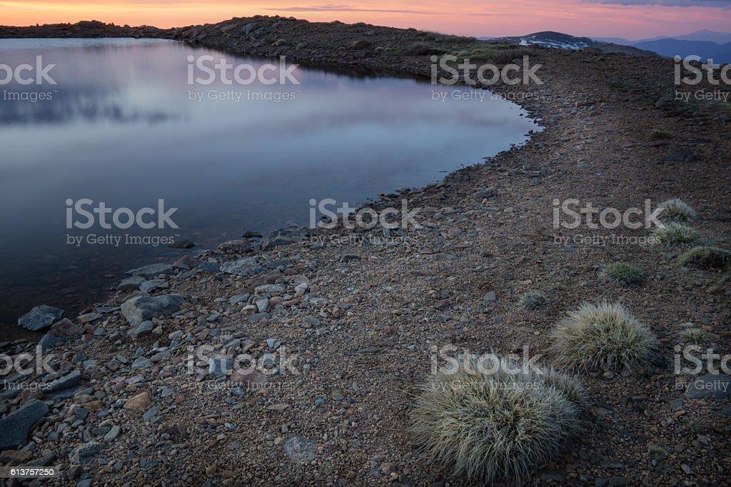 Sunrise on Alpine Lake stock photo
