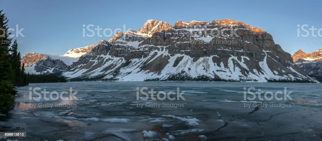 Sunrise on Bow Lake and Crowfoot Glacier in Banff stock photo