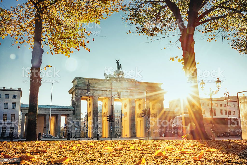 sunrise on Brandenburger Tor in Berlin in golden autumn stock photo