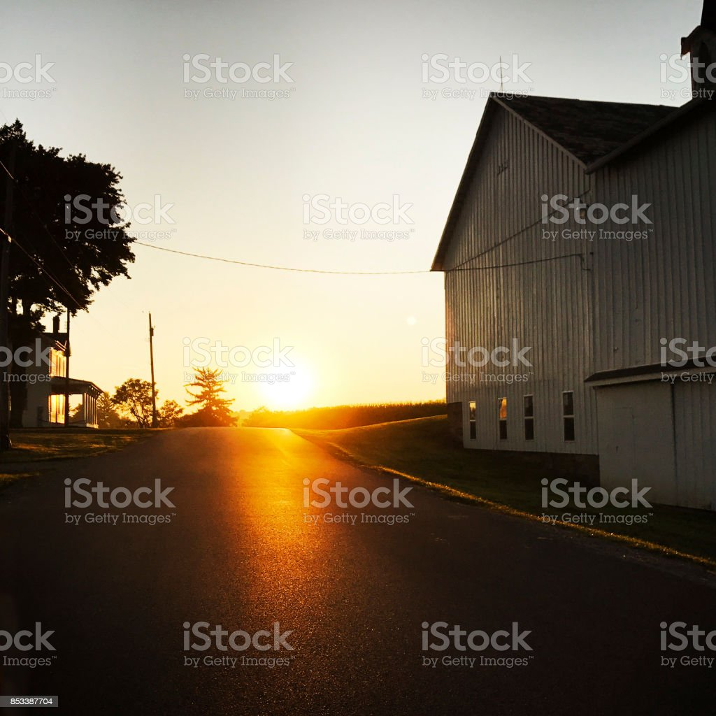 Sunrise on Country Road with Barn stock photo