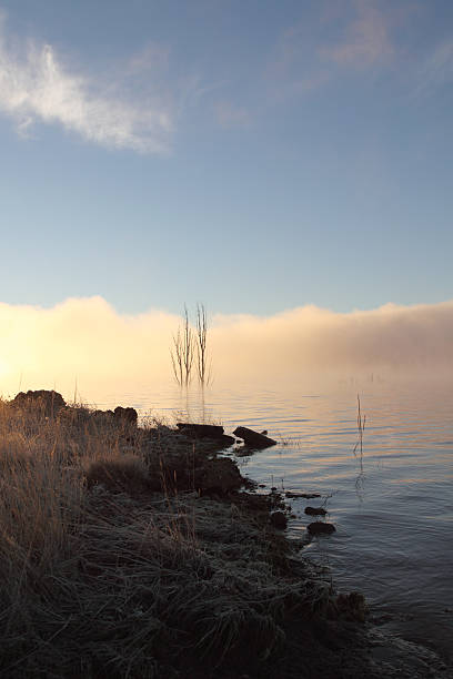 sunrise on lake eucumbene, nsw aust - lake eucumbene stock photos and pictures