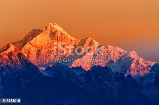 Beautiful first light from sunrise on Mount Kanchenjugha, Himalayan mountain range, Sikkim, India. Orange tint on the mountains at dawn