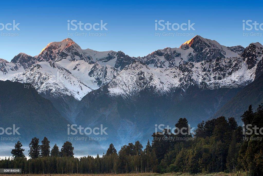Sunrise on Mt Cook and Mt Tasman, New Zealand stock photo
