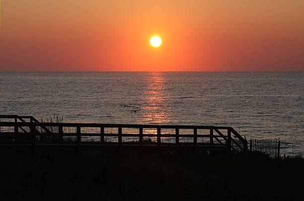 sunrise on ocean stock photo