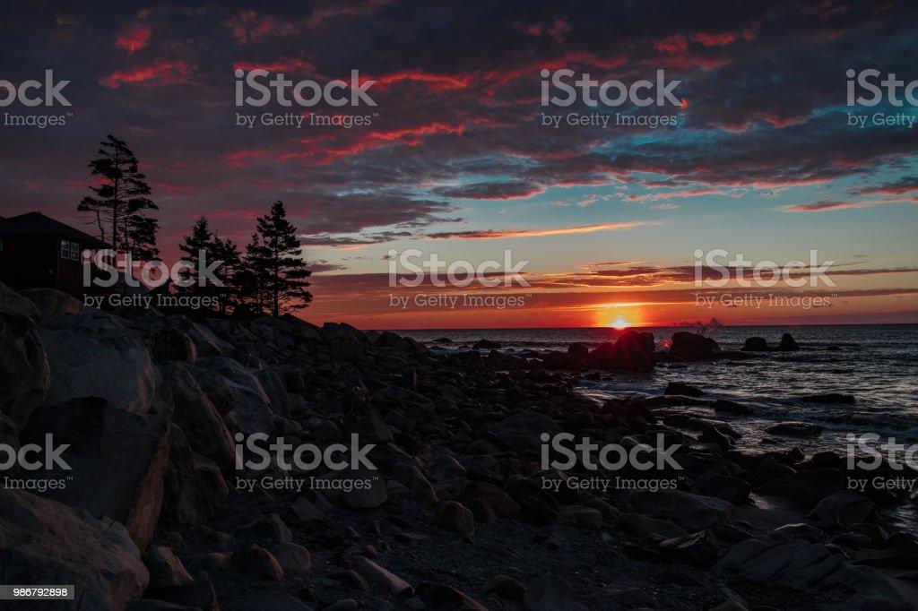 Sunrise on Rocky Coastline. stock photo