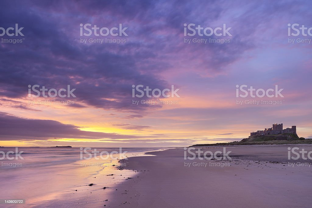 Sunrise on the beach at Bamburgh Castle, Northumberland, England stock photo