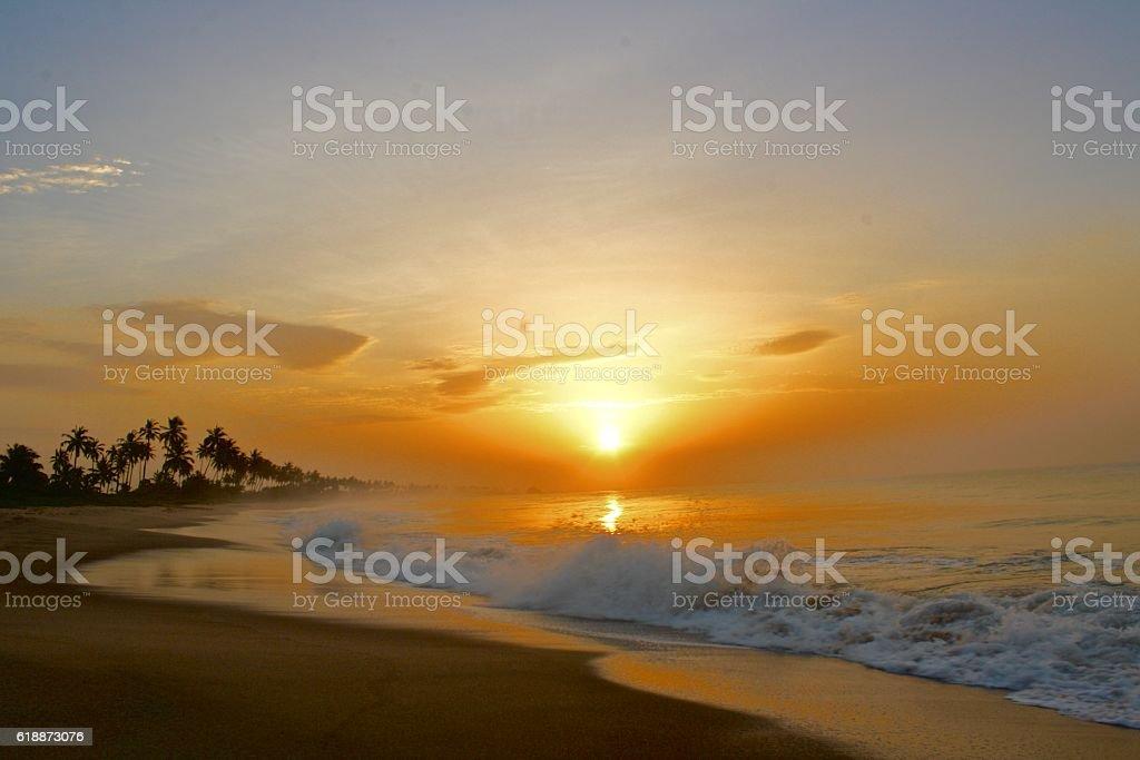 Sunrise on the beach in Ghana stock photo