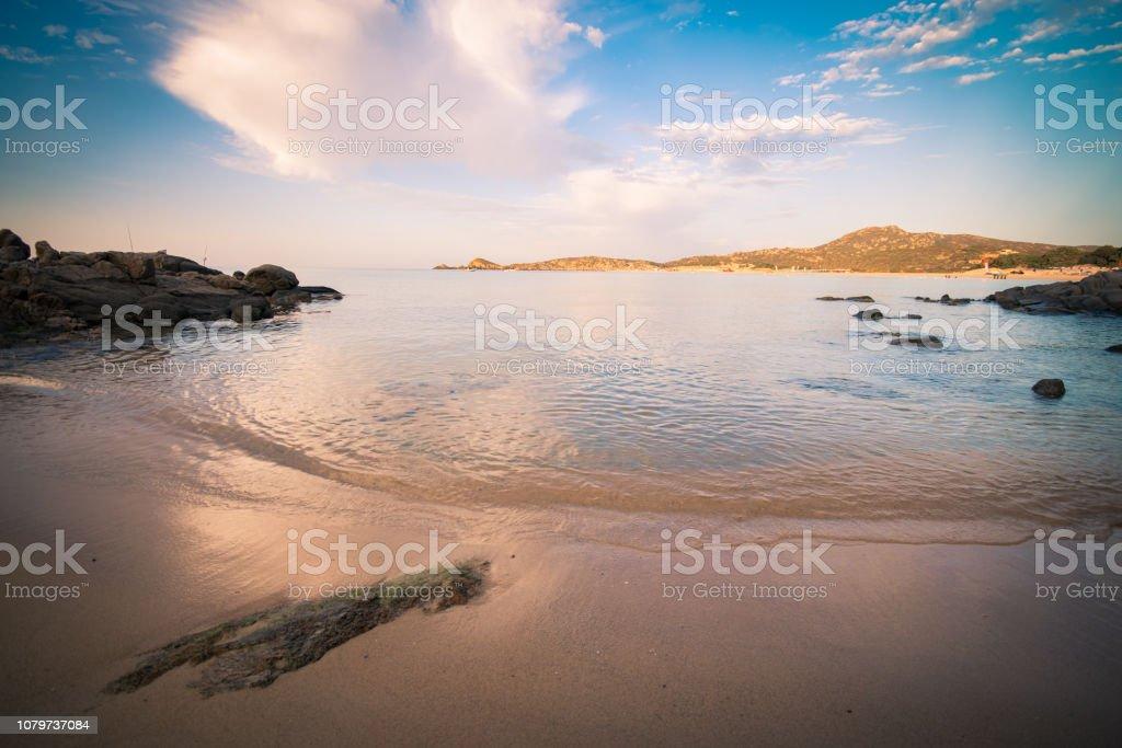 Sunrise on the beach of Chia, Sardinia, Italy. stock photo