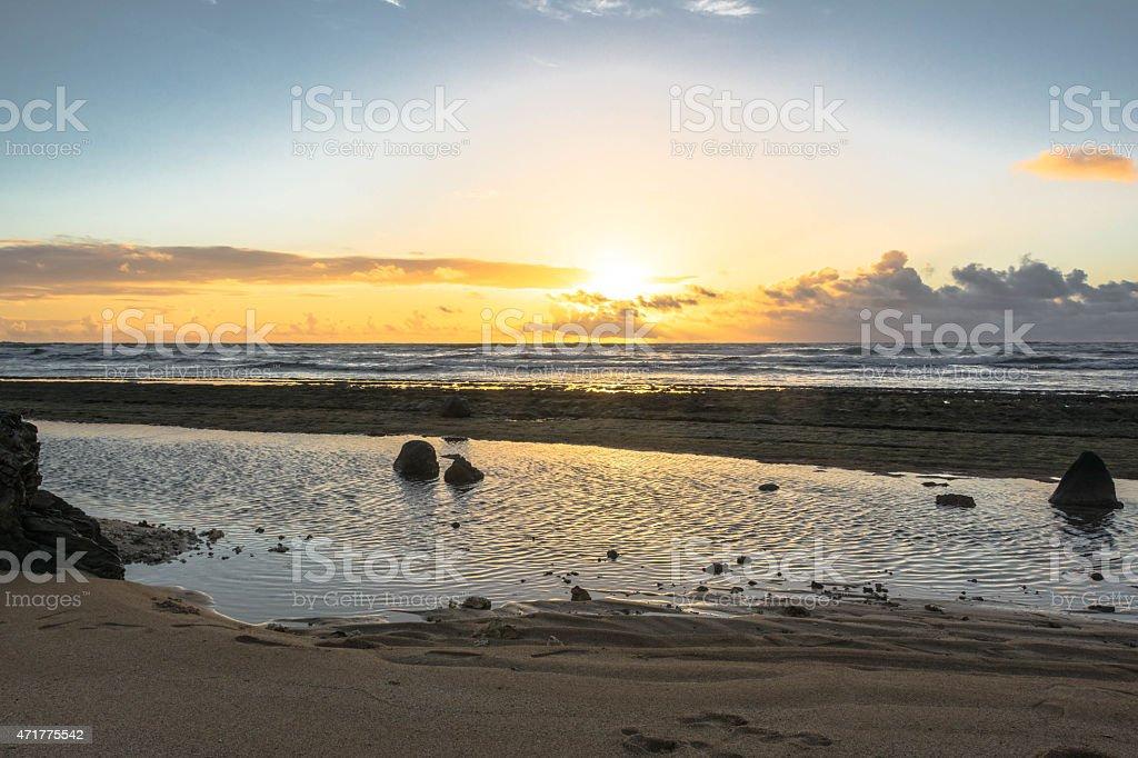 Sunrise on the ocean in Lihue, Hawaii stock photo