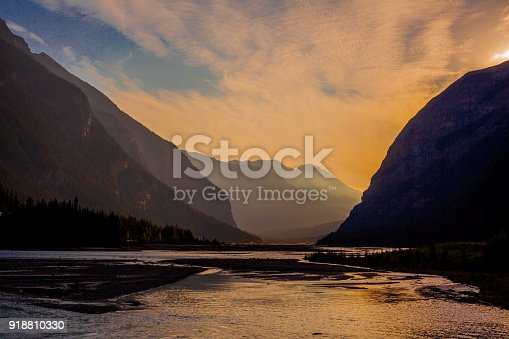 Day breaks on the river in the Canadian Rockies