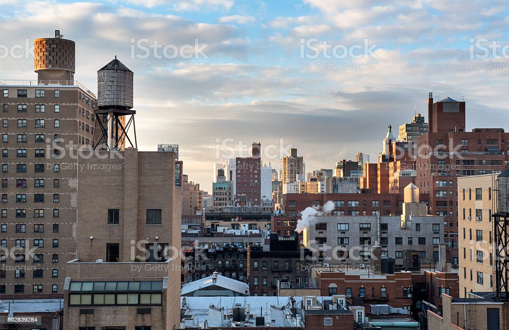 Sunrise on the rooftops in Manhattan stock photo