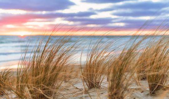 Sunrise on the sand beach on Rungen near Lobbe