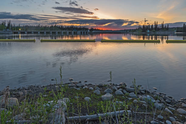Sunrise on the Seebe Hydroelectric Dam on the Bow River and Kananaskis River Seebe hydroelectric dam near Exshaw, Alberta kananaskis country stock pictures, royalty-free photos & images