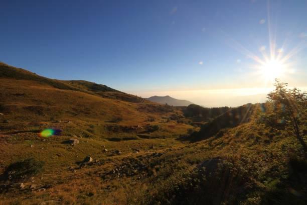 Sunrise on the top of Cimone mount stock photo