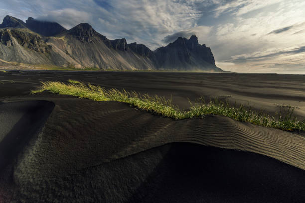 Sunrise on Vestrahorn Mountain, Iceland Vestrahorn, on the Stokksnes peninsula in Iceland, has dramatic peaks reaching up to 454 meters. black sand stock pictures, royalty-free photos & images