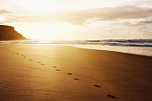 Beautiful remote beach with one person's footprints.