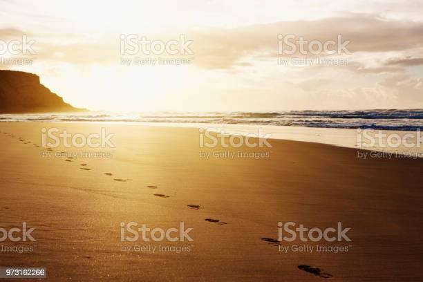 Sunrise or sunset highlights footprints of a lone beach stroller picture id973162266?b=1&k=6&m=973162266&s=612x612&h=5kod5l6lqjd8dl 4byqll8xaht8z6ceqzwtzezfgdmw=