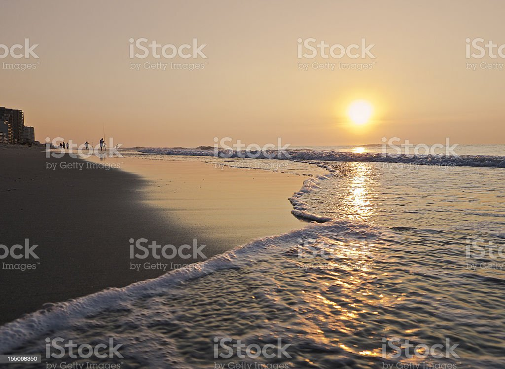 Sunrise or sunset over ocean waves royalty-free stock photo