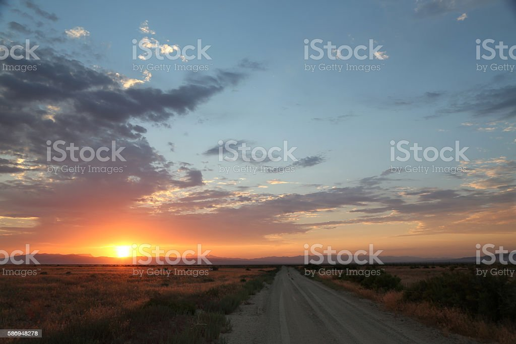 Sunrise over a backcountry road stock photo