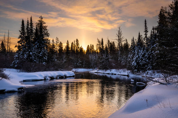 Sunrise over a creek in winter stock photo