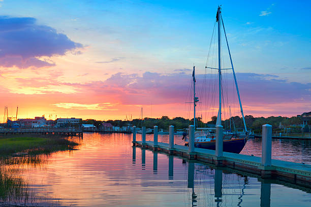 Sunrise Over A Docked Sailboat In Charleston South Carolina Sunrise Over A Docked Sailboat In Charleston South Carolina  south carolina stock pictures, royalty-free photos & images