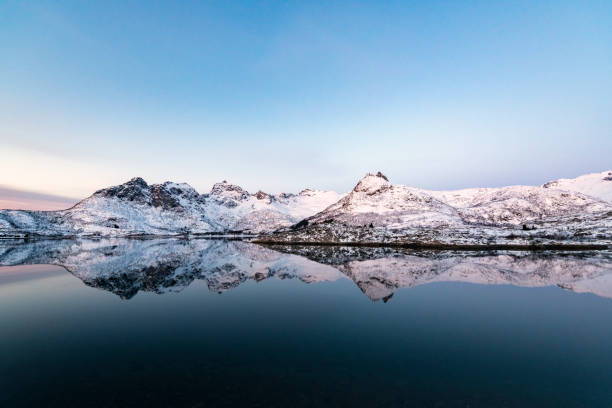 Sunrise over a Fjord in the Lofoten during a cold winter morning stock photo