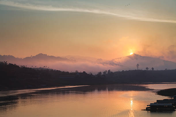 Sunrise over a Lake in the West of Thailand stock photo