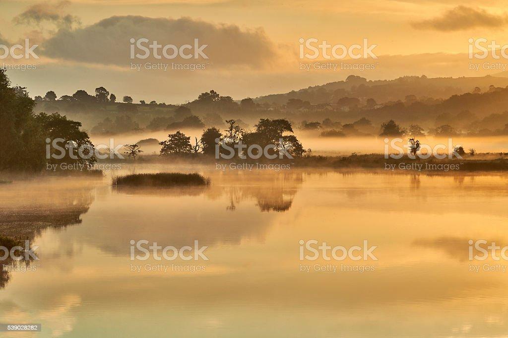 Sunrise over a misty lake.Ireland stock photo