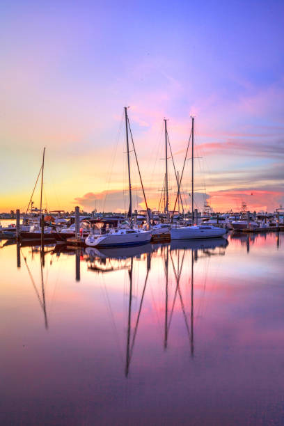 Sunrise over a quiet harbor in old Naples, Sunrise over a quiet harbor in old Naples, Florida during the summer naples florida stock pictures, royalty-free photos & images