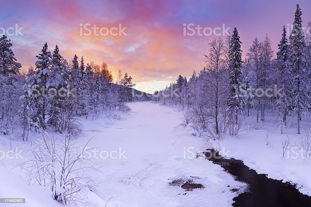 Sunrise over a river in winter near Levi, Finnish Lapland royalty-free stock photo