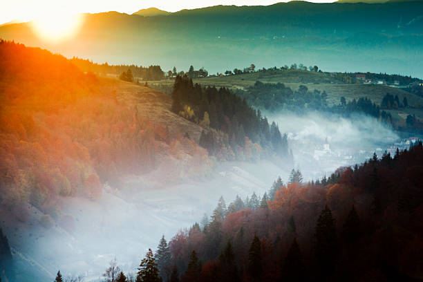 sunrise over a romanian village - romania stock photos and pictures