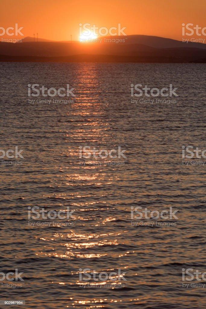 Sunrise over Aegean Sea and the Turkish coast stock photo