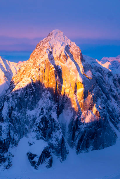 Sunrise over Alaskan mountains stock photo