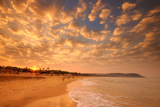 Sunrise over Candolim Beach in Goa, India  goa stock pictures, royalty-free photos & images