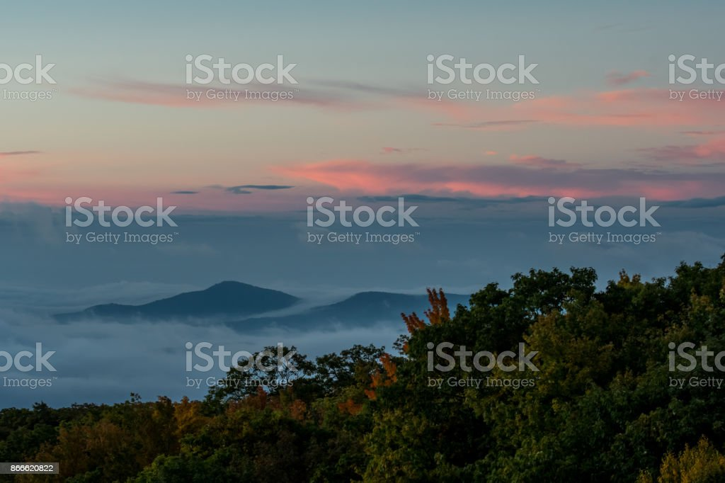 Sunrise over Cloud Covered Valley stock photo