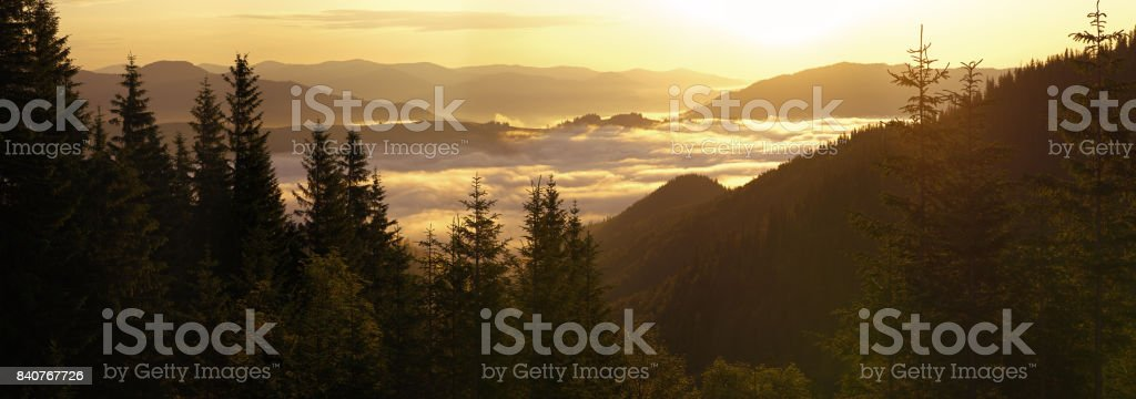 Sunrise over clouds in the mountains stock photo