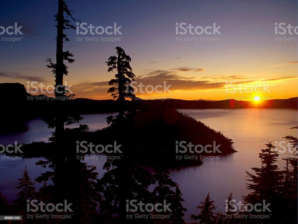 sunrise over crater Lake stock photo