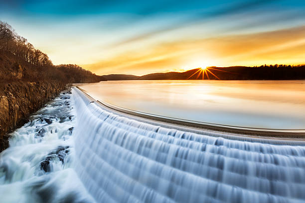 sunrise over croton dam, ny - overflowing stock photos and pictures