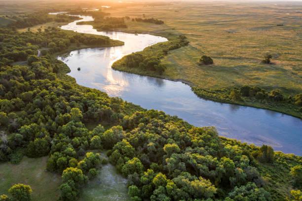 sunrise over Dismal River in  Nebraska Sandhills stock photo
